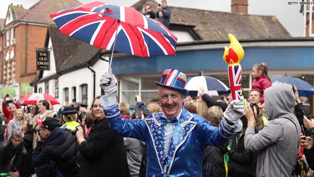 A local resident cheers on the Torch Relay in Petersfield, U.K.; photo via LOCOG