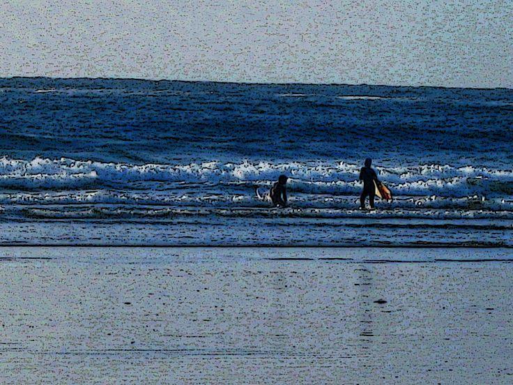 Cold water surfers, Tofino, BC