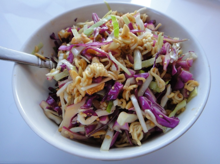 Crunchy Asian Noodle Salad: 2 packs ramen (Oriental flavor)  5-7 cups shredded cabbage, 1/4cup sliced scallions, 1/2cup sliced almonds, 2Tbsp sesame seeds  (Optional - 1/2 cup carrot, red bell pepper or chicken) Lightly pan toast ramen & almonds, toss in sesame seeds at end. Combine toasted mixture w/ cabbage/scallions in bowl. DRESSING: 2 ramen seasoning packs, 6Tbsp sugar, 1/4cup veg oil, 1Tbsp sesame oil,  6Tbsp. rice vinegar, 1Tbsp soy, 1Tbsp grated ginger. Pour onto salad & toss.