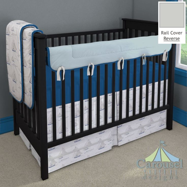Crib bedding in Watercolor Sailboats, Solid Royal Blue Minky, Solid Silver Gray, Solid Robin's Egg Blue. Created using the Nursery Designer® by Carousel Designs where you mix and match from hundreds of fabrics to create your own unique baby bedding. #carouseldesigns