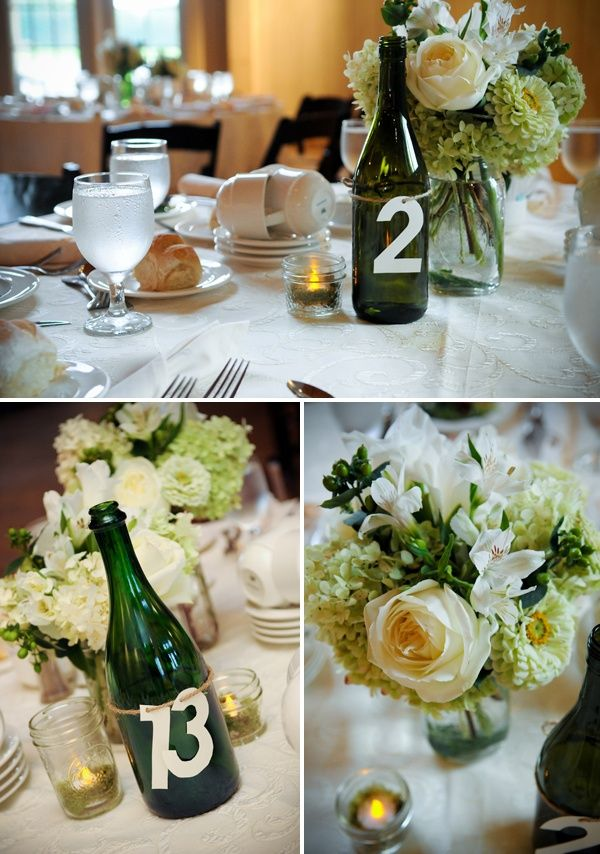 7 awesome DIY wine bottle centerpiece ideas for your big day! | Wedding Party.....I love how the #'s are tied around the bottle....could tie around a tall centerpiece