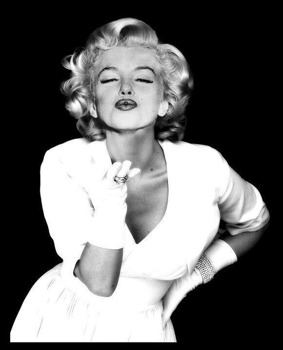 Marilyn Monroe blows a kiss.