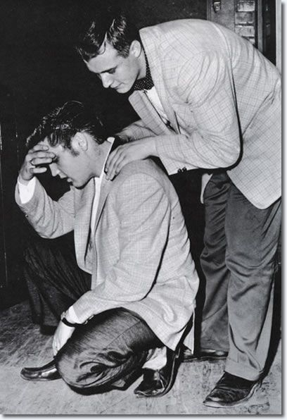 Elvis Presley, exhausted after a matinee performance given at the Auditorium in St. Paul, Minnesota