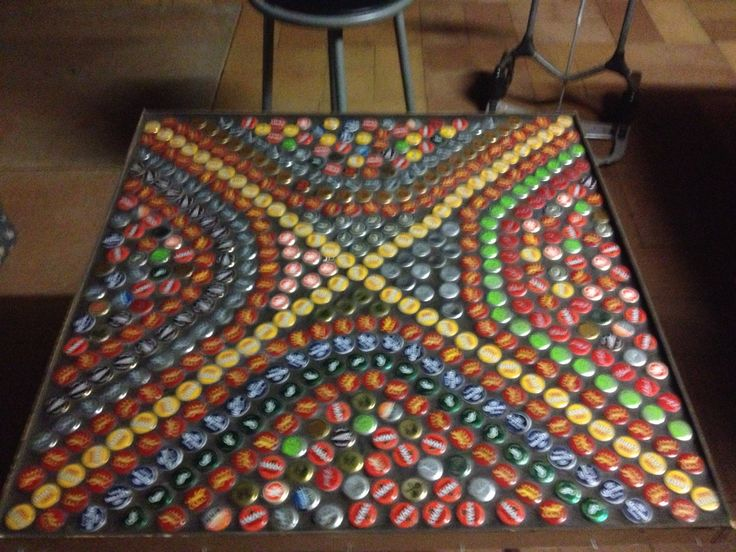 Bottle top table.  I used black grout, and casting resin