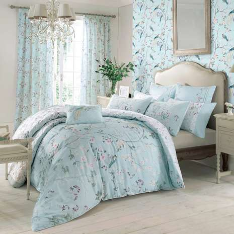 Adorned with embroidered birds and Chinoiserie style floral detailing in shades of pink and duck egg blue with piped edge detailing, this luxurious Dorma duvet ...