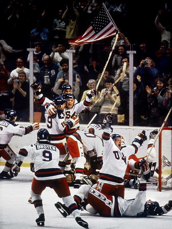"""""""Team USA upsets Team Russia in the 1980 Olympic Men's Ice Hockey Semi-Final.  The clutch goaltending of Jim Craig and a monumental go-ahead goal by Mike Eruzione enabled the U.S. to win 4-3, inspiring broadcaster Al Michaels to utter his famous """"Do you believe in miracles?"""" The next day, the U.S. rallied to beat Finland for the gold."""""""