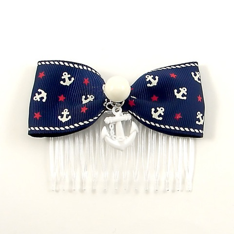 Rockabilly Sailor Doll Comb:Punk Up Bettie writes, Calling all sailor dolls! This hair comb is just the thing to go with that little nautical outfit! Perfect for a day at sea or for everyday wear! Bow is navy blue with white anchors and red stars throughout and approximately 3 3/8 , white circle button is approx. 1/2, white anchor charm is 7/8 at... $10.00