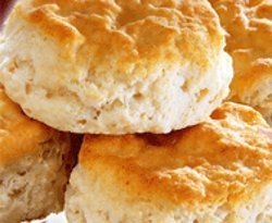 KFC Buttermilk Biscuits  2 cups flour 1/4 teaspoon baking soda 1 Tbs baking powder 3/4 cup buttermilk 1 teaspoon salt 6 Tbs Butter  Sift  dry ingredients in a large bowl. Cut in the butter until a coarse texture is obtained. Add buttermilk and knead gently but thoroughly. The dough should be soft but not sticky: if it is, add a little more flour. Knead for 1 minute, wrap in foil or wax paper and refrigerate for at least 20 minutes. Bake 450 for 10-12 mins.
