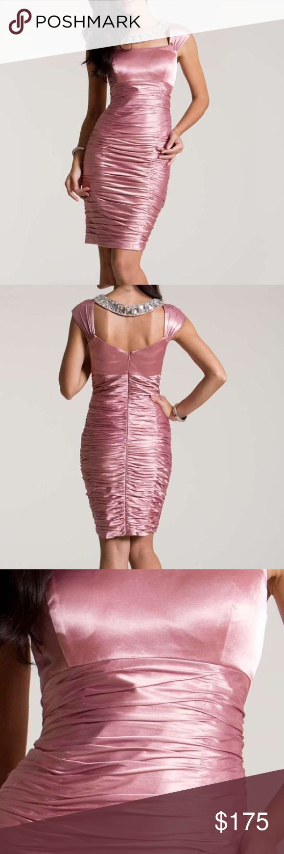 Beautiful Pink Nika Dress Lovely and sweet, this charming cocktail dress by Nika 8093 is a pretty and playful choice for your next party. A unique bejeweled necklace leads to cap sleeves and a cutout neckline. Sleek to the empire waist, this fabulously ruched look will hug your curves and enhance your figure. This body conscious dress is sure to make him smile. NIKA Dresses