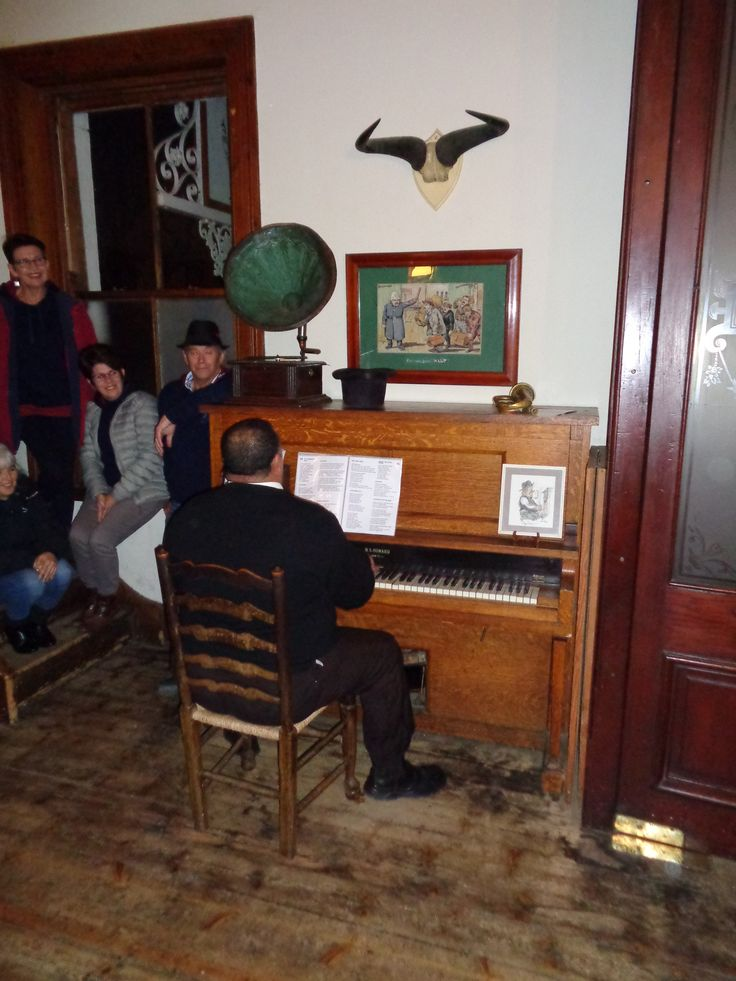 Singalong in the pub of the Lord Milner hotel, Matjiesfontein