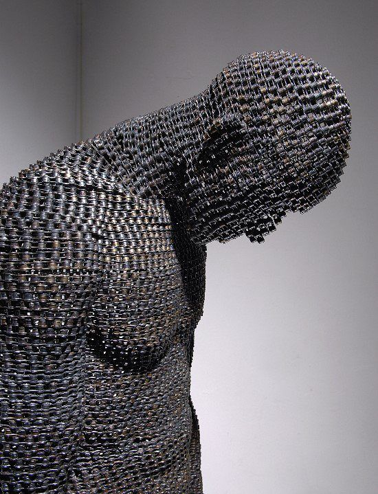 This sculpture is of a man and is made entirely in chain. The man's face is hidden from view, and in combination with the use of chain, it makes me think of him as a prisoner. This could be a cool study in how the materials affect the thoughts of the viewer.