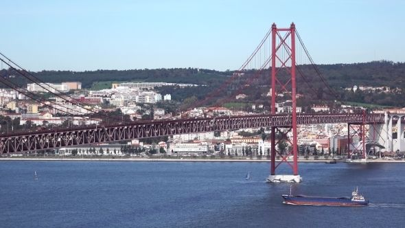 View On The 25 De Abril Bridge In Lisbon by Discovod View on the 25 de Abril Bridge in Lisbon, Portugal
