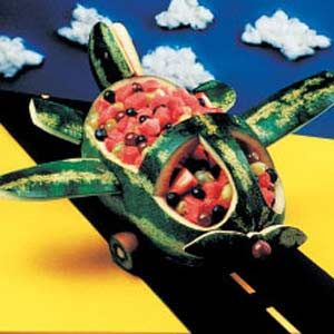 If you need a fruit salad recipe, a watermelon shaped like an airplane is the perfect bowl!