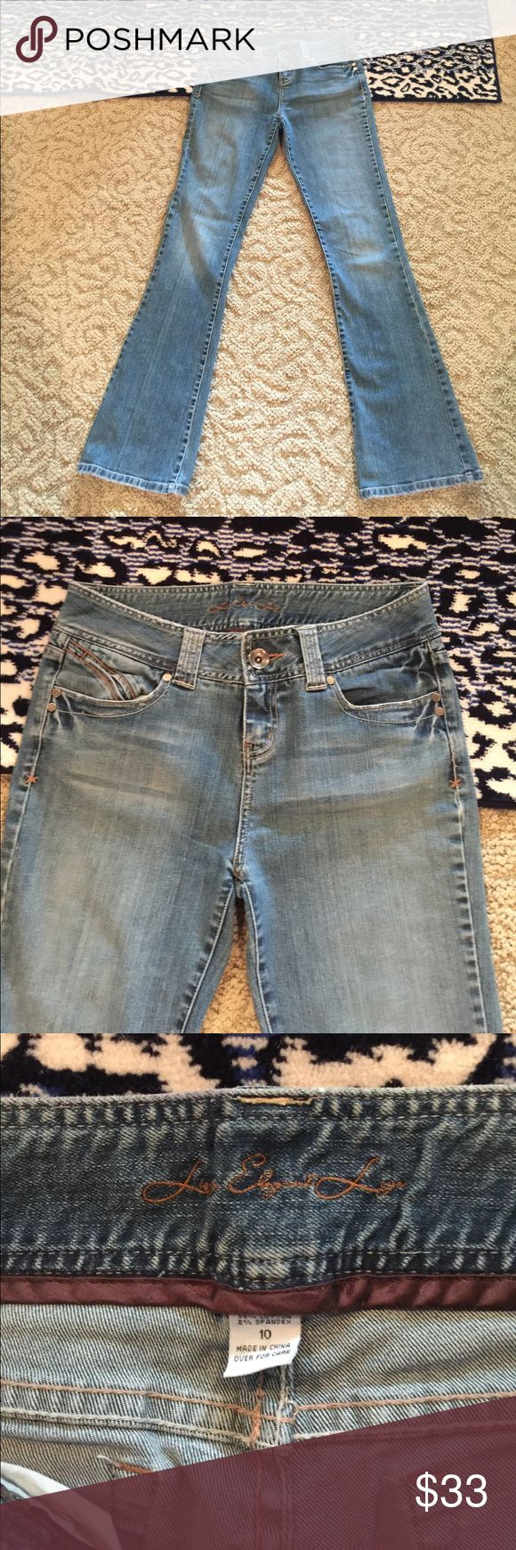 LEL BELL FLARE JEANS SIZE TALL 10 WIDE WAISTBAND LONG ELEGANT LEGS JEANS WITH SPANDEX TALL 10 WIDE WAISTBAND FLARE LEG VINTAGE DISTRESSED COLOR WITH BOTTOM OF LEG RAGGED 34 inch inseam Long Elegant Legs Jeans