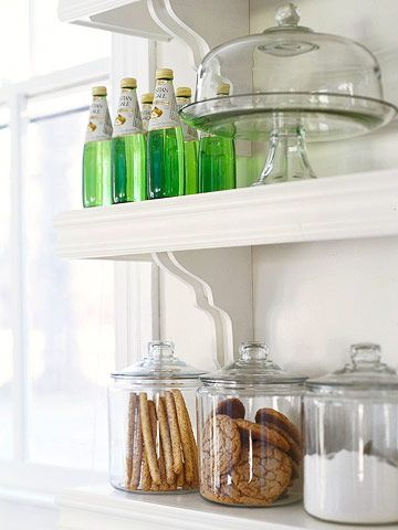 Decorative brackets dress up open shelving while molding edges keep items from falling. Home centers and online sources sell a variety of similar brackets. Or try brackets made from cast iron, painted to match or accent the shelves.