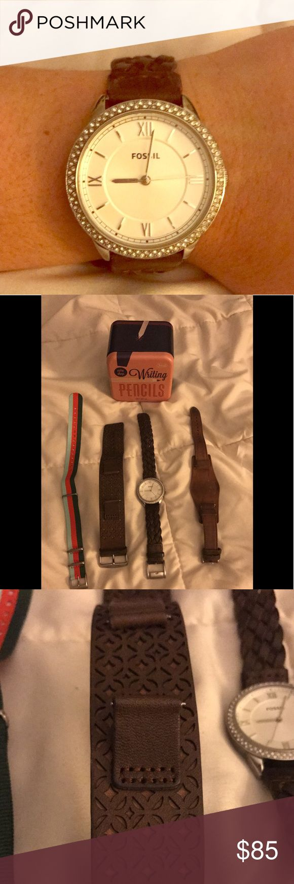 Silver Fossil watch and bands ⌚️ Beautiful silver Fossil watch with rhinestone detail. Comes with 4 Fossil interchangeable bands: one plain tan leather, one woven brown leather, one detailed brown leather cuff, one colorful striped nylon. Can purchase more watch bands to switch up the style! Fossil Accessories Watches