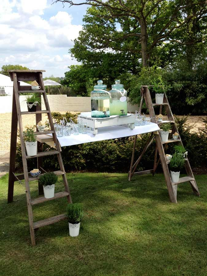 Old ladders to make a tressel-what a fab idea! Would look great with potted flowers to give it some colour