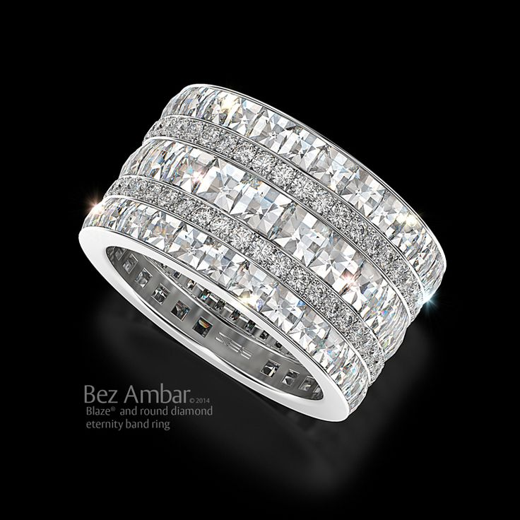 A bewitching and creative design of a five row eternity band with a unique blend of different size Blazes accentuated by two rows of pave diamonds.