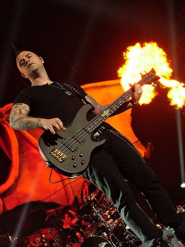 HIS BASS IS ON FIRE. At least, that's what it looks like XD