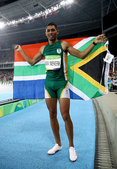 Wayde van Niekerk of South Africa celebrates after winning the Men's 400 meter…