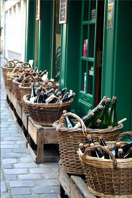 | P | Buying wine off the sidewalk in France.