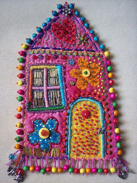 Beaded House,    Embroidery and Beads on cotton,batting and felt house hanging.