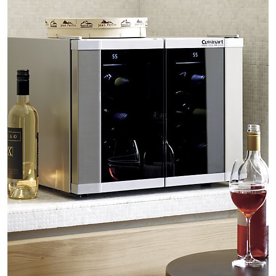 An exciting development in wine storage. Exclusively ours and the first of its kind, this dual-zone wine cellar keeps up to 12 bottles at two separate temperatures on contoured, removable chrome racks. Patented electronic touchpad thermostat keeps wines at your choice of two temperatures between 39 and 68 degrees.