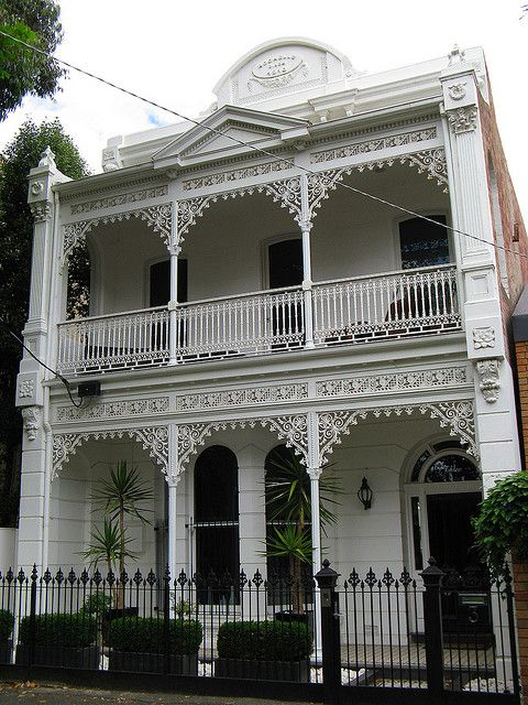 The inscription on the pediment reads 'Rochelle circa 1910', which could make this Edwardian era built, Victorian terrace house one of the last of its kind to be constructed in Melbourne. The St Kilda building has been beautifully restored and features an elaborate pedimented twin level iron lacework verandah, flanked by fluted Corinthian pilasters on the upper level and a palisade fence.
