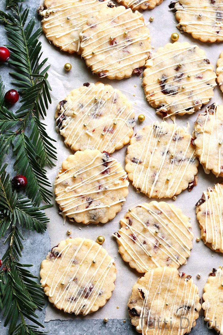 Bright and buttery cranberry orange shortbread cookies drizzled with white chocolate are a must bake for every holiday cookie platter.