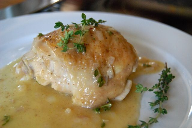 Pan-seared chicken thighs with a beer and mustard sauce.