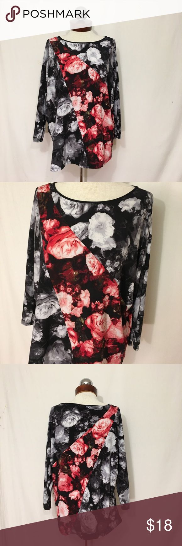 ELLEN TRACY rose print stretch top Excellent condition! A black and white rose floral print is offset by a diagonal fully colored  panel. Dolman cut sleeves, slouchy fit. Polyester/spandex; has stretch. Bust 51 length 26 Ellen Tracy Tops Blouses