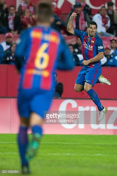 Barcelona's Uruguayan forward Luis Suarez celebrates after scoring during the Spanish league football match Sevilla FC vs FC Barcelona at the Ramon...