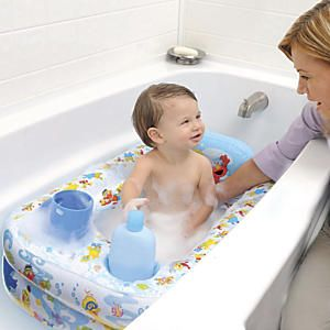 Sesame Street Inflatable Safety Bathtub: Ease the move from the baby tub with this large inflatable toddler bathtub, featuring playful Sesame Street® characters! Loaded with luxury features: a headrest for easy shampooing, supply cubbies to keep soap and shampoo close, and a water temperature display for safety. Featuring Elmo, Cookie Monster, Big Bird, Zoe, and Bert and Ernie, to help make bath time more fun...