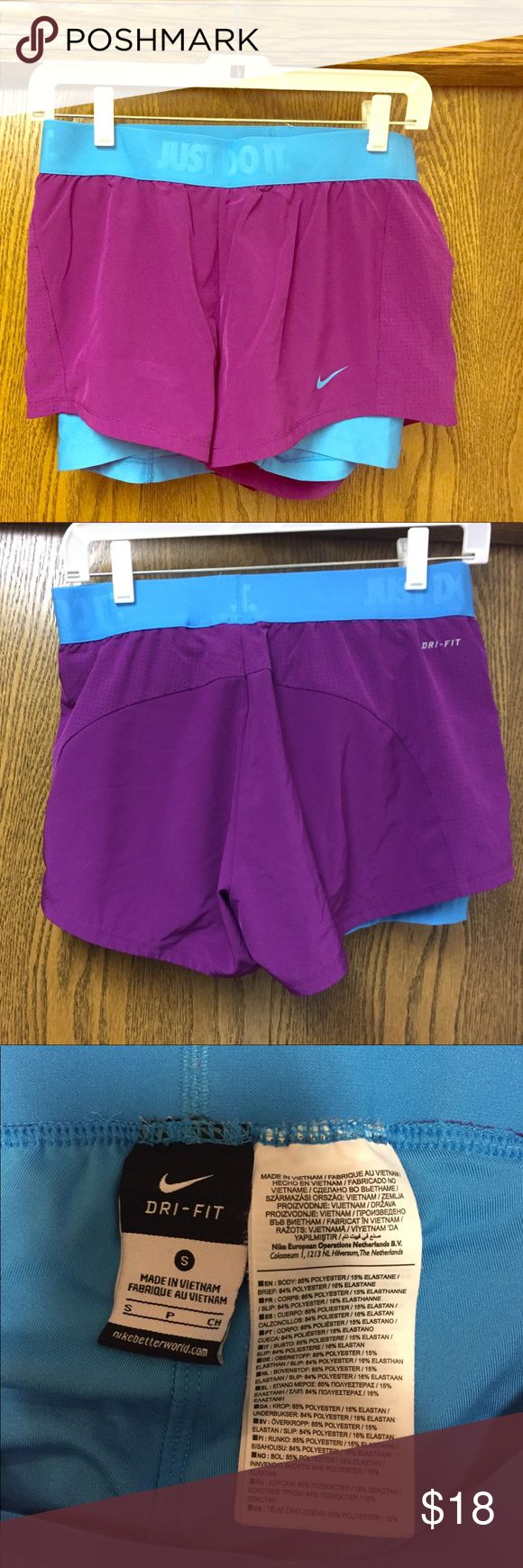 Women's Nike Running Shorts with Spandex Purple shorts with blue spandex and waistband accents, worn only a few times! Nike Shorts