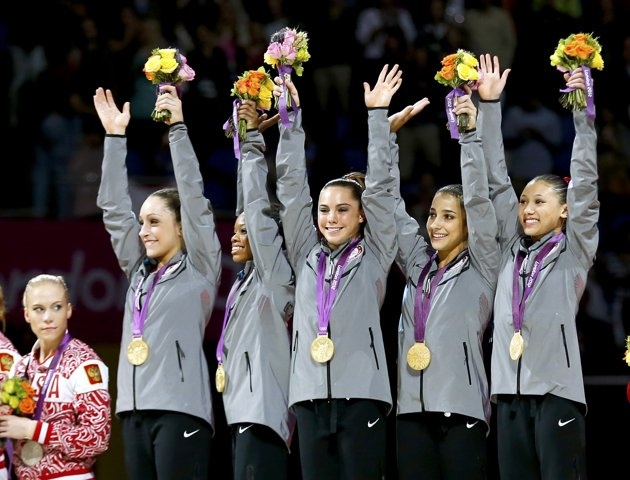 Team U.S.A members, Gabrielle Douglas, Alexandra Raisman, Jordyn Wieber, McKayla Maroney and Kyla Ross celebrate with their gold medals in London