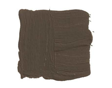 """BENJAMIN MOORE MUSTANG 2111-30: """"In an all-white house, I'll often do one room, like the study or the TV room, that's a total reversal. I'll paint it very dark, like this espresso brown, so you have a completely different feeling. Darkness creates intimacy. With a big daybed that works for two, you can lie down and watch a movie. Bring in deep blues and reds. Actually, every color looks good with it."""""""