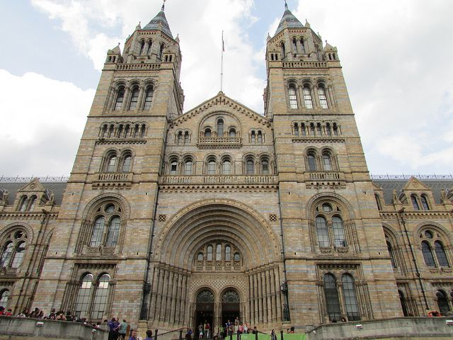 Grand - The Natural History Museum in London is a grand building with all of the culture and nature that has ever existed all packed into one great building. It is very detailed and fits in with the other famous buildings around London.