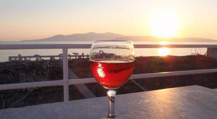 enjoying a wine glass during sunset