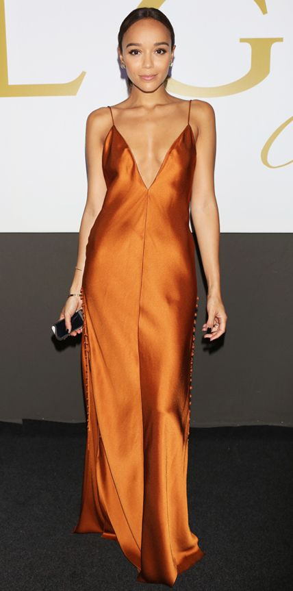 Ashley Madekwe wearing a bronze satin Wes Gordon gown with tiny button detailing along the back and sides.