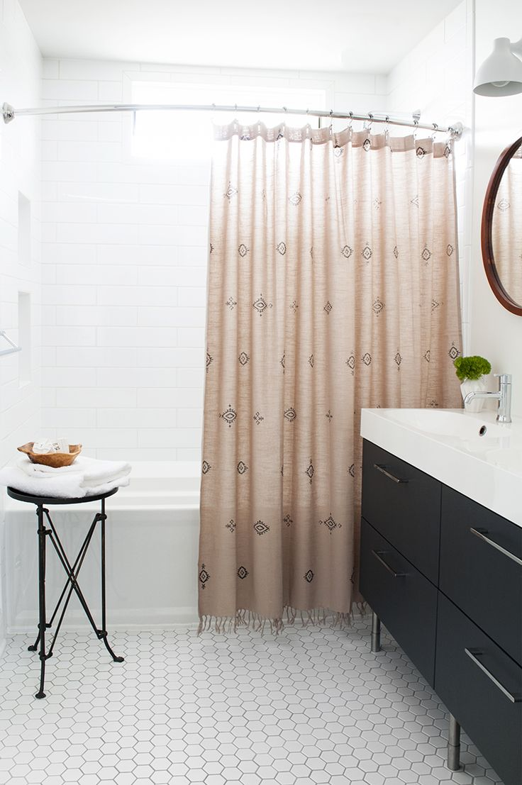 A Boho Bathroom - hex floor tile with grey grout, long subway tile in tub