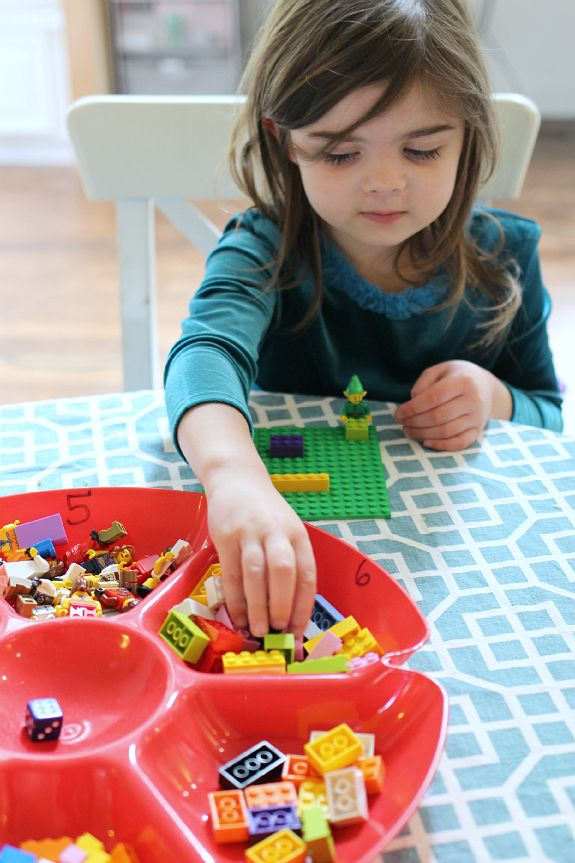 LEGO  6 bowls with different pieces, roll a die & pick a piece out of the bowl--build with what you roll