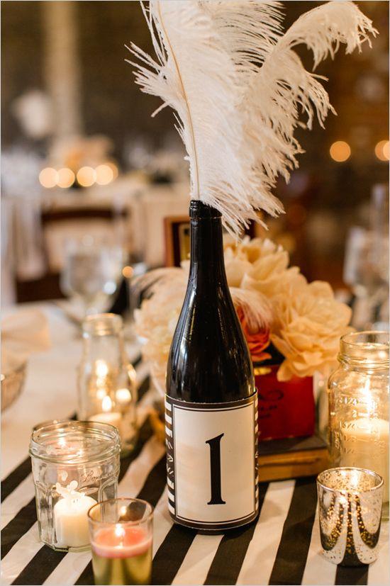 wine bottles with custom labels as table numbers #artdecowedding #corkplacecards #weddingseating http://www.weddingchicks.com/2014/01/13/diy-dapper-deco-wedding/
