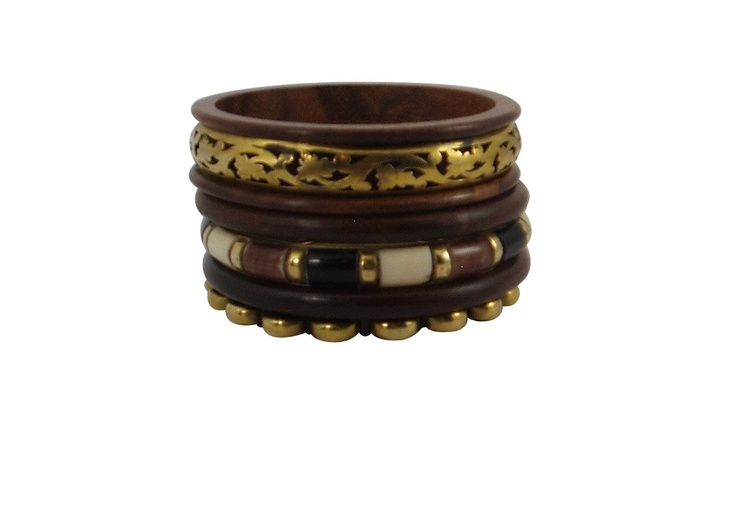 This set of 5 bangles includes bangles with scroll work, hand embossed bangle set inside a rich brown rims. The delicate leaf and vine pattern runs all around the bangle. There is one bamboo inspired bangle in brown, white and black color with brass stations .There are three rich wood bangles and one wave pattern antique finish gold tone bangle, all hand made.