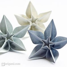 These absolutely beautiful origami flowers were designed by Carmen Sprung.Each flower is folded from a single sheet of paper, not from a square though, but from a pentagon. To find out how to fold them follow the link in the description section.  As for paper, I would recommend using fairly thick and strong paper (80-90 gsm) – Tant origami paper will be just the right choice!