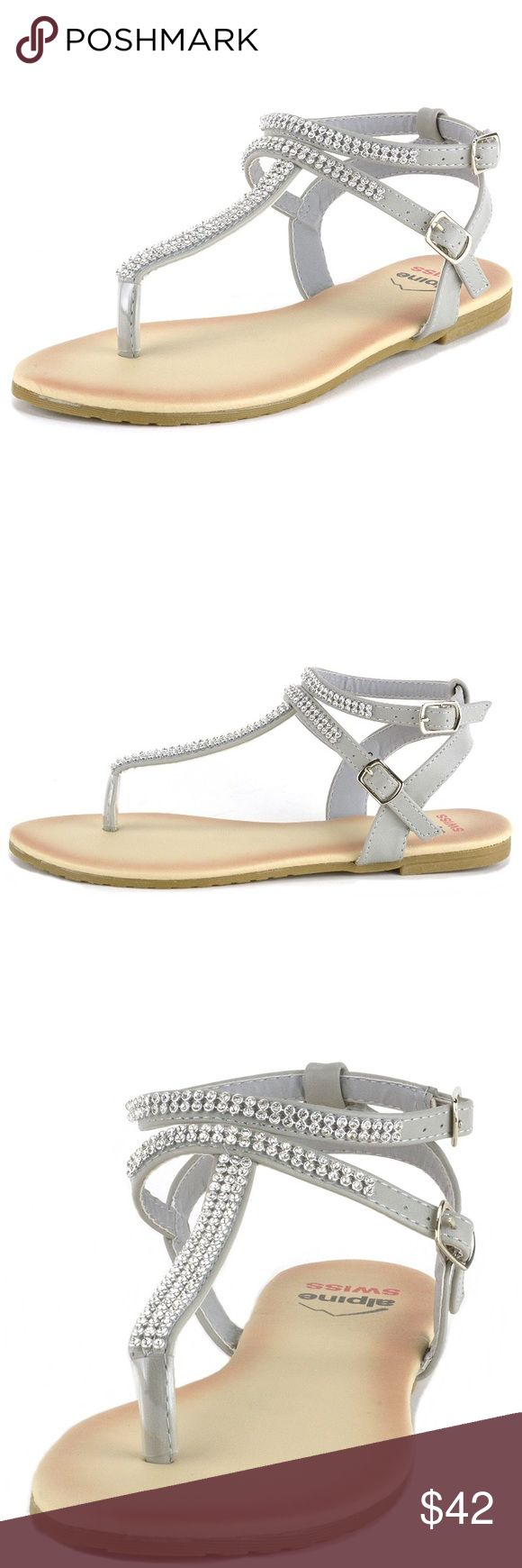"Slingback T-Strap Rhinestone Ankle Strap Sandals Slingback T-Strap Rhinestone Ankle Strap Sandals. Features a  Rubber Sole with Man-made Upper Slingback T-Strap Sandals with Rhinestone Accents Light Padding for Comfort 1/2"" Flat Sandals Medium Width Rubber Sole Shoes"