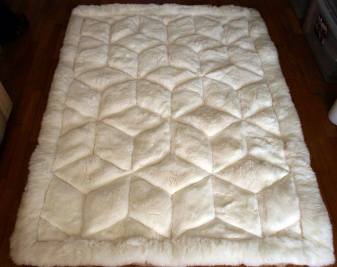 Similar to the alpaca rug I want. Mine would be sewn with octagons.