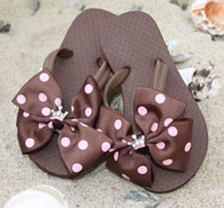 Flip flops with brown and pink polka dot bows...fun to change out the bows with your outfit or swim suit