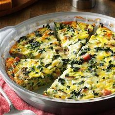 """Crustless Spinach Quiche Recipe -I served this dish at a church luncheon and I had to laugh when one gentleman said to me, """"This is good, and I don't even like broccoli!"""" I replied, """"Sir, it isn't broccoli. It's spinach."""" He quickly answered, """"Oh, I don't like spinach, either, but this is good!"""" —Melinda Calverley, Janesville, Wisconsin"""
