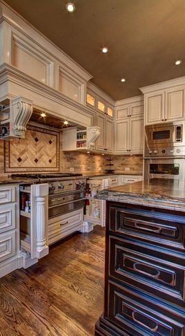 Kitchen Cabinets - love how the corbels next to the stove slide out for spices, cooking oil, etc.