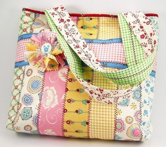 """Here is a shabby-chic style tote bag embellished with matching flower pin. It measures about 11"""" high and 13"""" wide and has two-inch gussets. The handle drop is 9.5""""."""